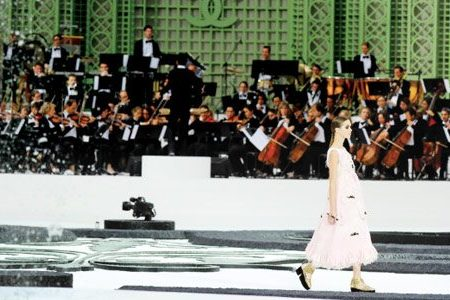 An 80-strong Philharmonic Orchestra at Chanel Spring 2011. Photography by Peter Stigter.