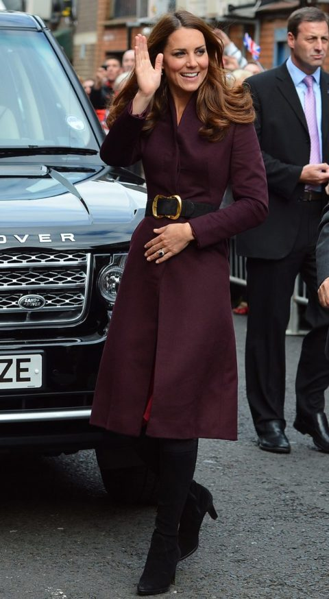 The Duchess Of Cambridge in an aubergine coat of her own design