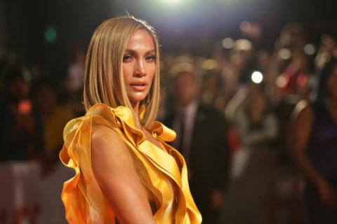 jennifer lopez wearing a yellow dress at TIFF 2019