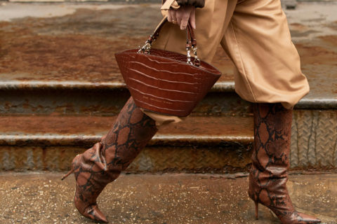 pants tucked into boots streetstyle closeup brown snakeskin