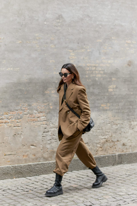 camel suit pants tucked into boots