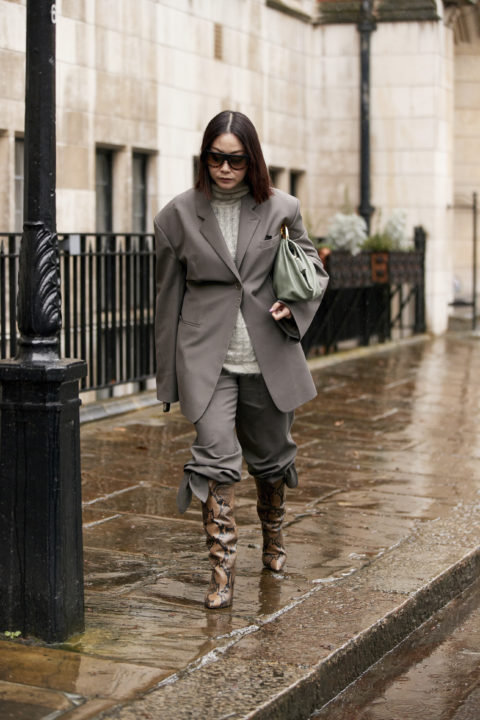 grey and snakeskin pants tucked into boots