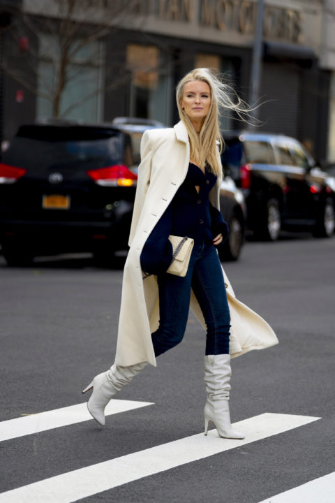 white coat pants tucked into boots