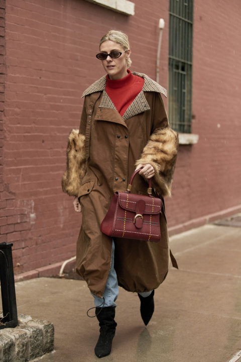 brown trench pants tucked into boots