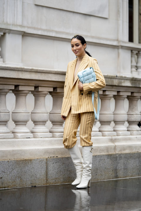 striped suit pants tucked into boots