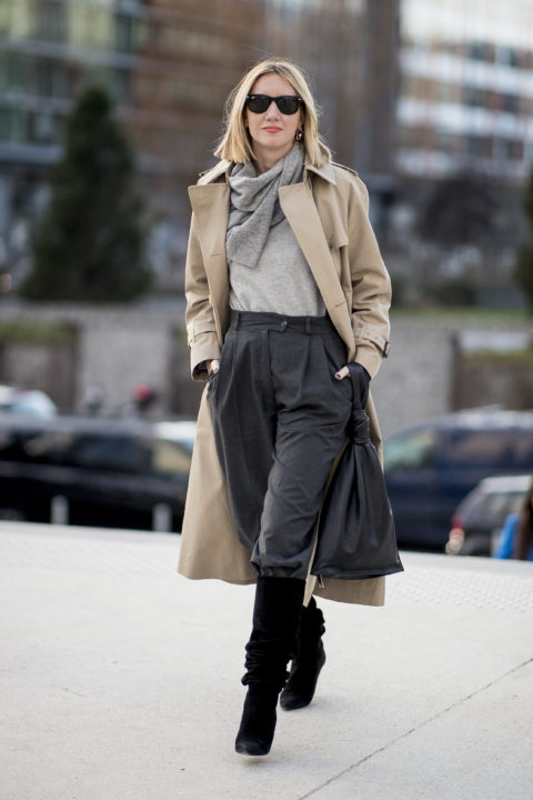 coat and scarf pants tucked into boots