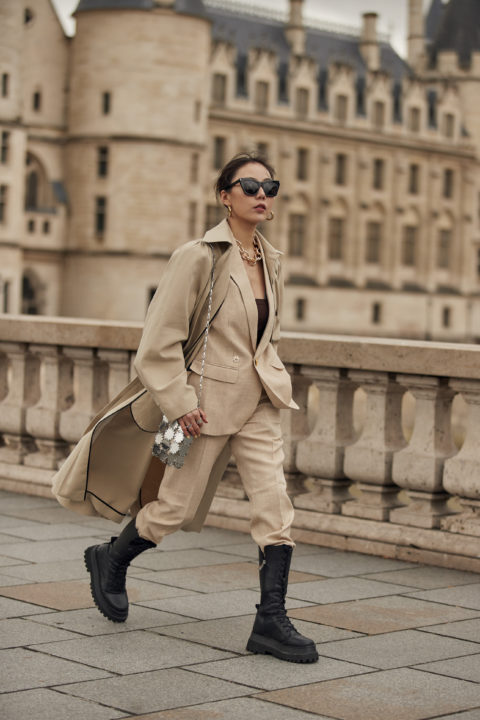 beige suit pants tucked into boots