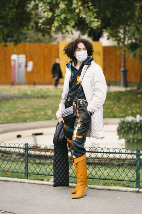 quilted jacket pants tucked into boots