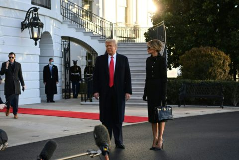 Outgoing US President Donald Trump and First Lady Melania Trump speak to the media as they depart the White House in Washington, DC, on January 20, 2021