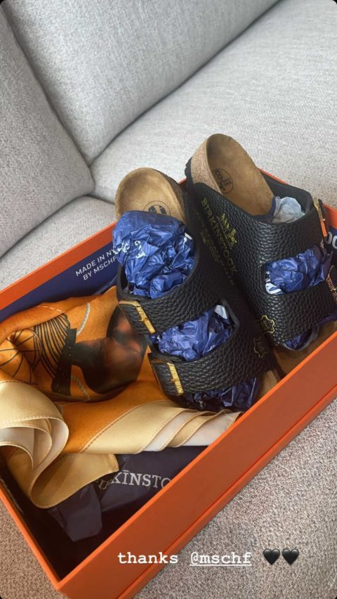 A pair of 'Birkinstock' sandals made out of an Hermès bag