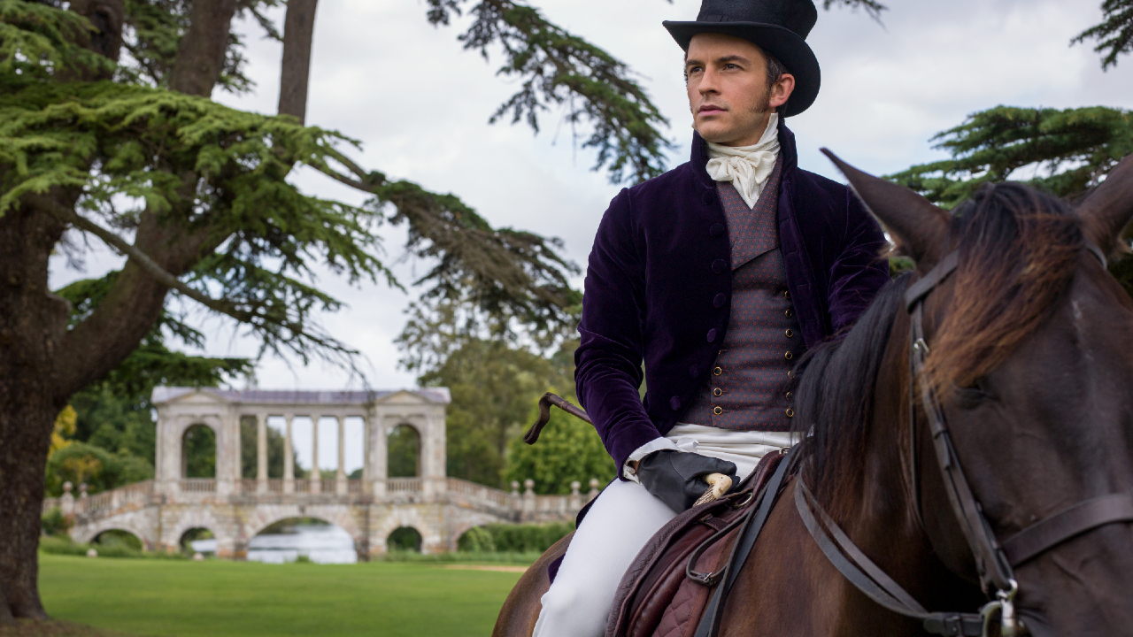 Jonathan Bailey as Anthony Bridgerton, on horseback looking off into the distance, in episode 101 of Bridgerton