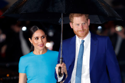 Meghan Markle and Prince Harry holding an umbrella as they arrive at the Endeavour Fund Awards in 2019