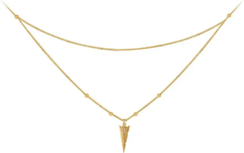 A gold necklace featuring an arrowhead decorated with diamond