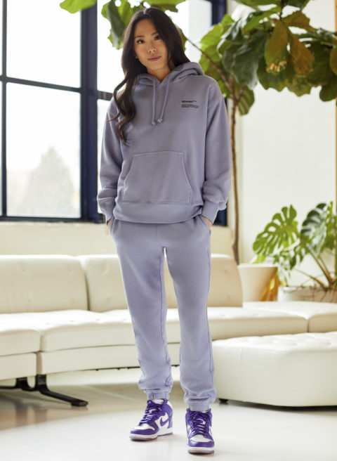 A photo of a woman wearing a lilac-coloured sweatsuit from Aritzia
