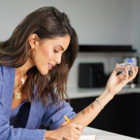 Camila Coelho with an Elaluz product