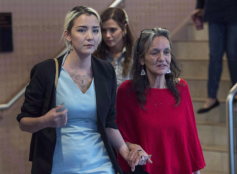 Delilah walks hand in hand with her mother Miriam Saunders after speaking during the National Inquiry into Missing and Murdered Indigenous Women and Girls Oct. 30, 2017 (Photo: Canadian Press)