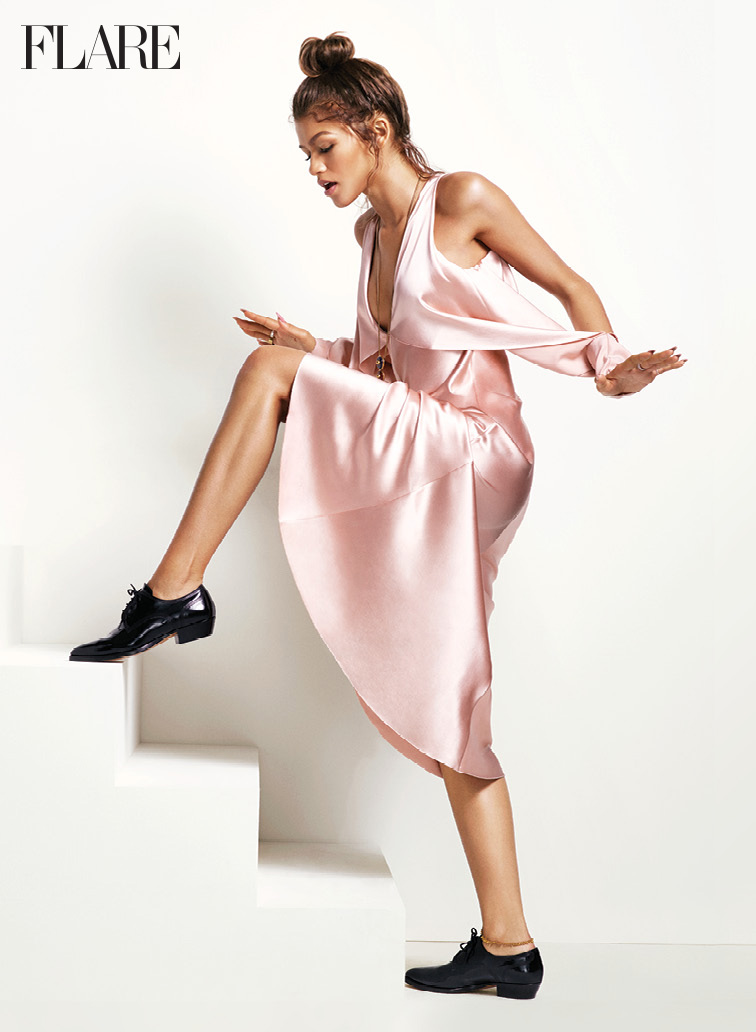 Dress, Dion Lee. Necklace and gold ring, both Tory Burch. Silver rings and anklet (worn throughout), all Zendaya's own. Shoes (worn throughout), Valentino. (Photo: Nino Muñoz. Styling: Sarah Schussheim. Styling consultant: Law Roach.)