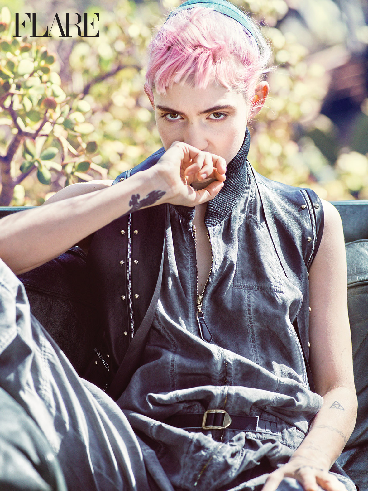 Leather vest, silk crepe jumpsuit and double necklace, all Louis Vuitton. (Photo: Nino Muñoz; Styling: Truc Nguyen)