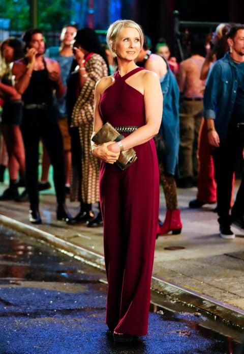 Cynthia Nixon wearing a red dress while filming