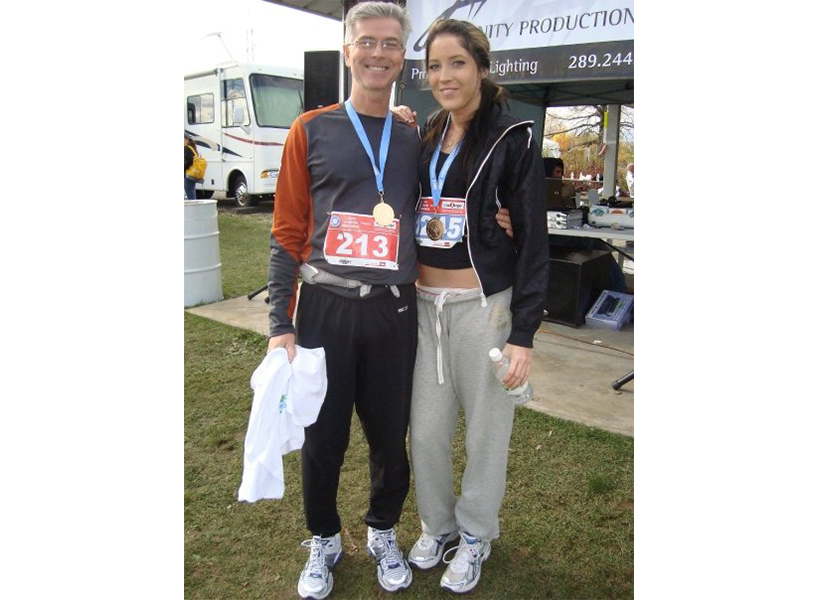 Avid runners, Dell and her dad loved to race together. They're pictured here before Dell was trafficked. (Photo: courtesy of Markie Dell.)