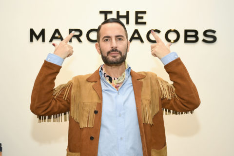 The designer in front of a Marc Jacobs sign