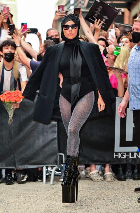 Lady Gaga wearing a black cape