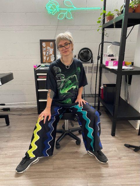 Tattoo artist salad sitting in Montreal studio